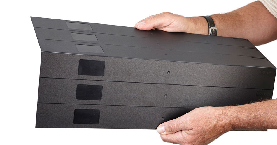 Man using hands to separate EziBlank blanking panel from group